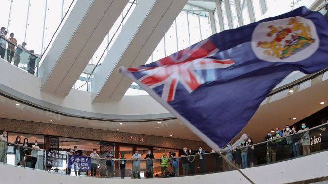 In this May 29, 2020, file photo, a protester holds a Hong Kong colonial flag in a shopping mall during a protest against China's national security legislation for the city, in Hong Kong. (Photo / AP)
