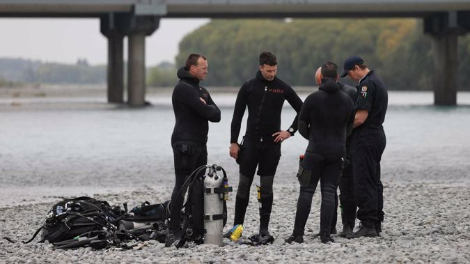 The dive squad at the Waimakariri River on Monday. (Photo / George Heard)
