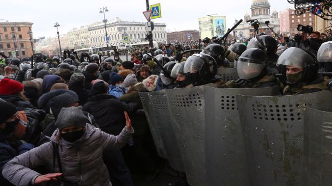 Police stand blocking approaches to the street as protesters try to break through during a protest against the jailing of opposition leader Alexei Navalny in St. Petersburg. (Photo / AP)