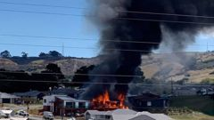 Pōkeno house fire: Drivers pull off State Highway 1 as home engulfed. / Supplied