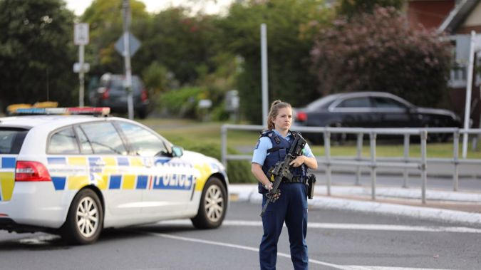 Armed police have closed Don Buck Rd in Massey, west Auckland due to an unfolding firearms incident. Photo / Hayden Woodward