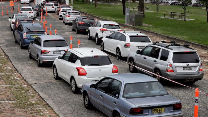 People queue at a drive-through Covid-19 testing station in Sydney on December 19, 2020. Photo / AP