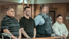Steven Kingi, left, Jessee Burns, a court security guard, and Stewart Hubbard in the dock at the High Court in Napier on Thursday. Photo / NZME