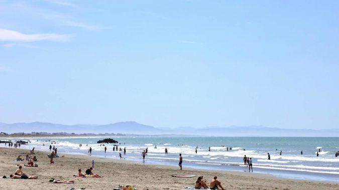 People enjoying the hot weather on Sumner Beach, Christchurch. Photo / George Heard