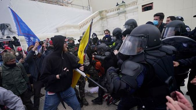 Rioters clash with police during the Capitol Hill Siege on January 6th. Photo / AP