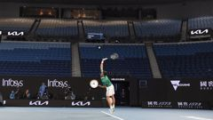 Novak Djokovic serves in front of a near-empty Rod Laver Arena during last night's Australian Open. Photo / AP