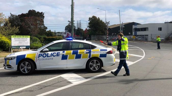 Police have cordoned off Matipo St, Riccarton, Christchurch as five fire crews deal with a shipping container hanging above LPG cylinders at a Kiwirail yard. Photo / NZ Herald
