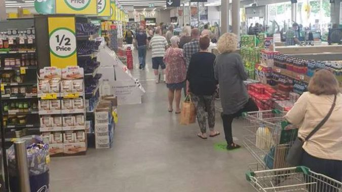 Long queues at a Melbourne supermarket after today's lockdown announcement. Photo / NZ Herald
