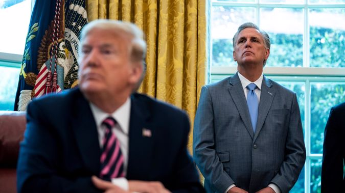 Former US President Donald Trump with House Republican leader Kevin McCarthy (right) in the Oval Office