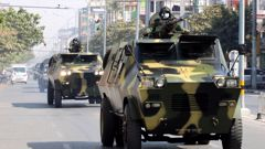 A military convoy heads through Myanmar streets. Photo / Getty Images