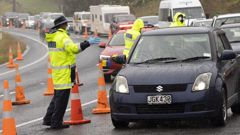 Police stop motorists at a Covid Police Checkpoint on State Highway 1 just south of the Brynderwyns, north of  Auckland. (Photo / NZ Herald)