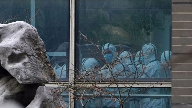 Members of the WHO team visit the Hubei Animal Disease Control and Prevention Center in Wuhan on February 2. (Photo / AP)