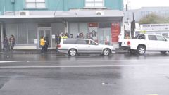 Anti-lockdown protestors gather outside Ardern's vacant Electorate office in Morningside. Video / NZ Herald