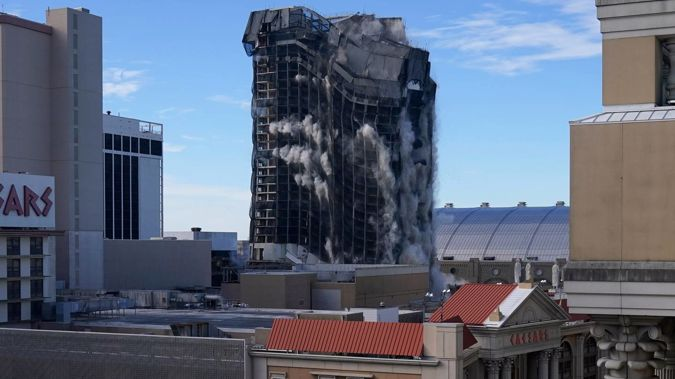 Overall, it took the structure less than 20 seconds to implode. (Photo / AP)