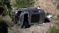 A vehicle rests on its side after a rollover accident involving golfer Tiger Woods along a road in the Rancho Palos Verdes suburb of Los Angeles. (Photo / AP)
