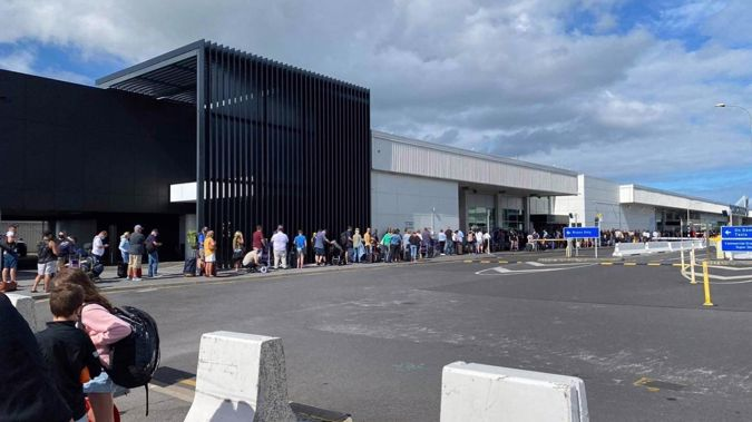 The queue at Auckland Airport was a couple of hundred metres long this morning causing lengthy delays for some travellers. Photo / Lauren Mabbett