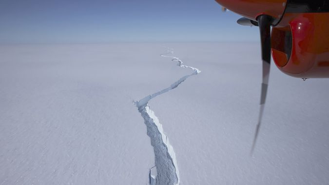 An airplane flies over the North Rift crack in the Brunt Ice Shelf in January. (Photo / British Antarctic Survey via AP)