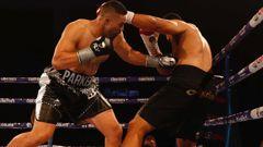 Joseph Parker punches Junior Fa. Photo / Dean Purcell