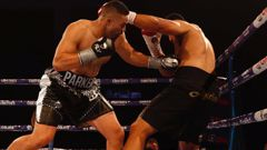 Joseph Parker punches Junior Fa. Photo / Dean Purcell