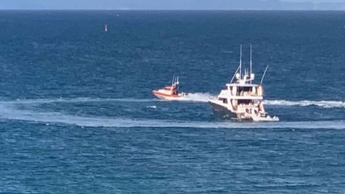 A circle is left in the water when a coastguard vessel leaves a rendezvous with a luxury launch at a Waiheke Island bay. Photo / Supplied