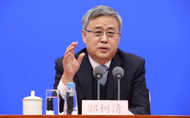 Guo Shuqing, the Communist Party boss at the People's Bank of China, told reporters in Beijing on Tuesday that confidence in Chinese markets could be hit by volatility around the world. (Photo / Getty)