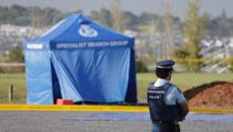 Police widen corden after body found in burning car at Auckland park