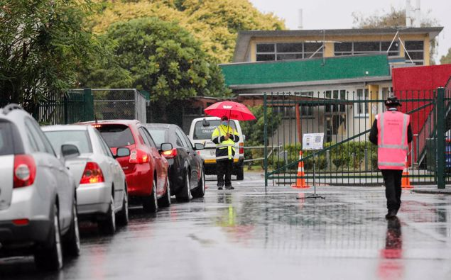 Cars line up outside the testing station at Papatoetoe High School on day one of the first alert level-3 Auckland lockdown. Photo / Dean Purcell