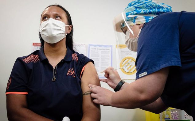 Lynette Faiva was the first New Zealand first MIQ worker to recieve the vaccine. (Photo / NZ Herald)