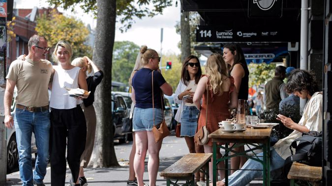 People in Ponsonby celebrate their newfound freedom in alert level two after level three restictions were lifted this morning. Photo / Alex Burton