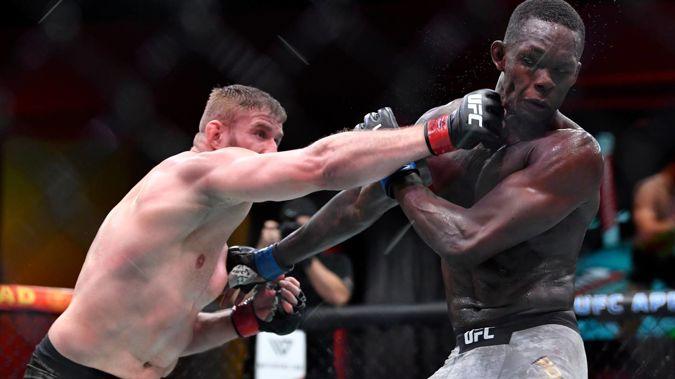 Jan Blachowicz lands a punch against Israel Adesanya. Photo / Getty