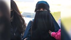Alleged Isis terrorist Suhayra Aden, right, is escorted into court by a Turkish police officer. Photo / Getty Images