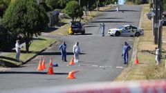 Police and forensic staff examine the scene at Pukemiro where Phillip Macpherson died on March 2019. Photo / NZ Herald