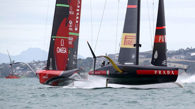 Team New Zealand and Luna Rossa battle it out in race one of the America's Cup Match. Photo / Getty Images