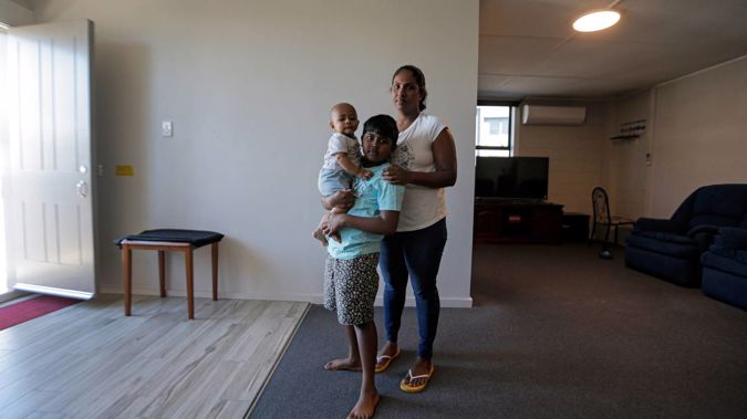 Widow Buddhini Sooriyaarachchi and her two children, Vinuga, 8, and Vinuth, 7 months, are at a loss about what to do after her husband Jeevaka Shayamal died suddenly aged 39. Photo / Alex Burton