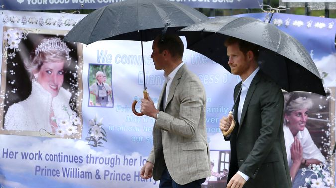 In this image, William, left, and Harry look at tributes left outside Kensington Palace to mark the 20th anniversary of Diana's death in 2017. (Photo / Getty)