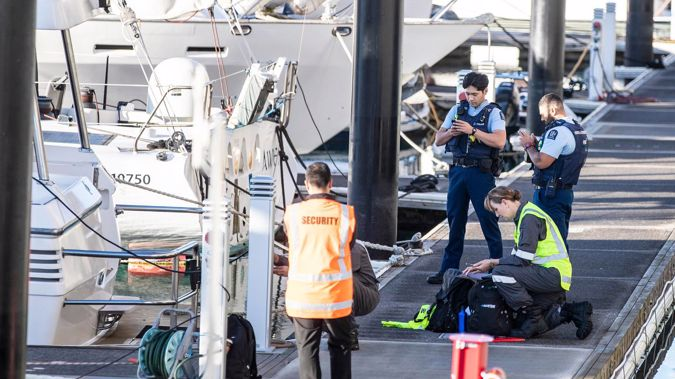 Police and maritime investigators try to piece together events leading up to a 25-year-old going overboard from charter boat yesterday. Photo / Michael Craig