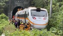 Train hits truck that slid onto track in Taiwan, killing 51