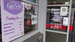 Easter trading hours are advertised at a New World supermarket in Wānaka. Photo / ODT