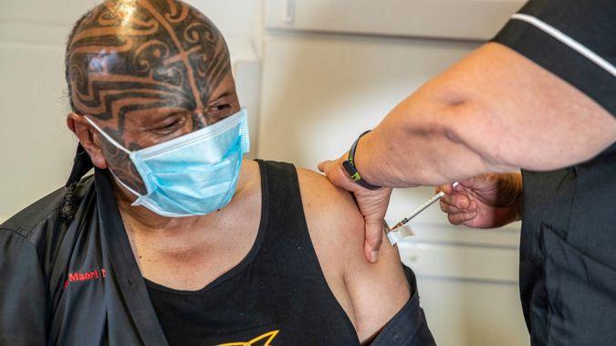 Manurewa Marae Board Chair Rangi McLean receives his first Covid-19 vaccination. Photo / Michael Craig