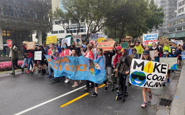 Students march to Parliament calling for urgent action on climate change. Photo / Nick James