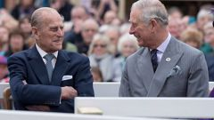 Prince Philip and his son Prince Charles listen to speeches before a statue of Queen Elizabeth, The Queen Mother was unveiled on October 27, 2016 in Poundbury, England. Photo / Getty Images