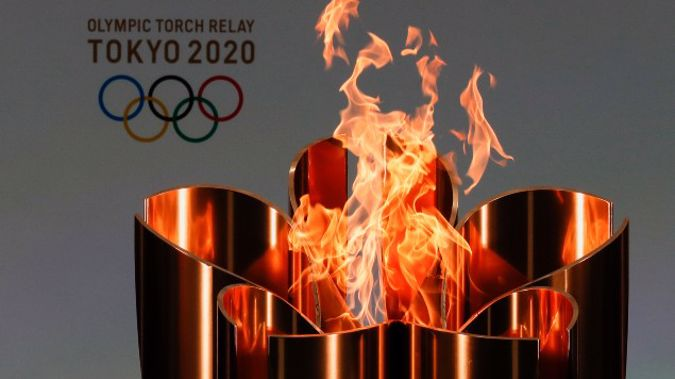 The celebration cauldron is seen lit on the first day of the Tokyo 2020 Olympic torch relay in Naraha, Fukushima prefecture, northeastern Japan. (Photo / AP)