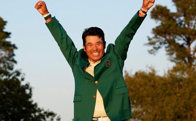 Hideki Matsuyama, of Japan, celebrates after putting on the champion's green jacket after winning the Masters golf tournament. (Photo / AP)