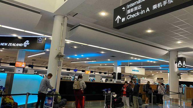 Travellers checking in at Auckland Airport, bound for Australia under the renewed, quarantine-less bubble arrangement. Photo / Juliette Sivertsen
