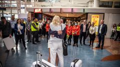 Passengers from the first quarantine-free flight from Sydney clear customs, Auckland International Airport. Photo / Michael Craig