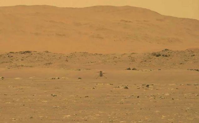 Nasa's experimental Mars helicopter Ingenuity lands on the surface of Mars. Photo / AP
