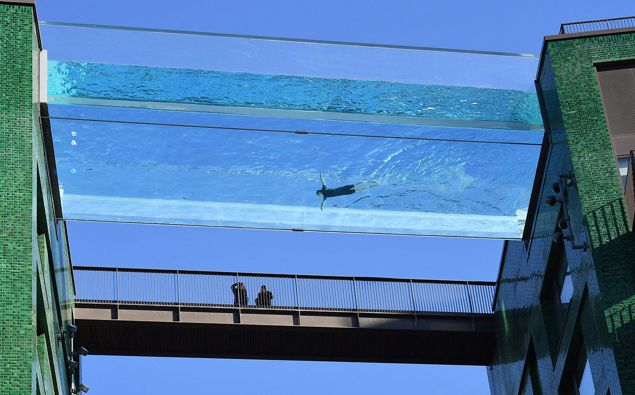 S world first, the transparent 25-metre-long outdoor pool, known as the Sky Pool, will allow residents to swim from one building to the other, 10 stories above the ground.