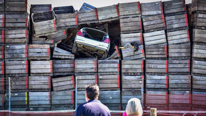 The car became lodged in the crates after fleeing police. Photo / Ian Cooper