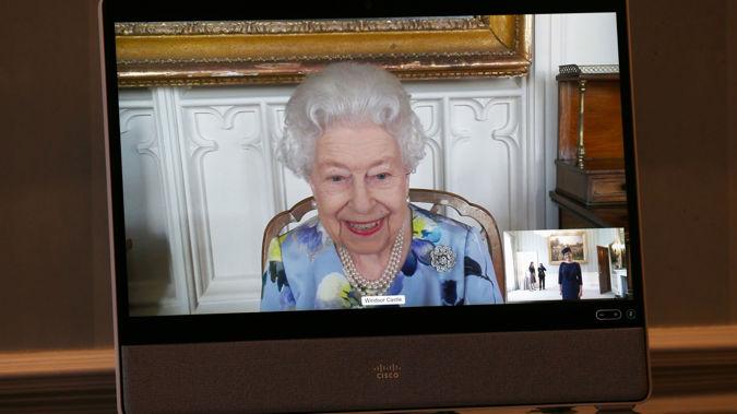 Queen Elizabeth II appears on a screen by video link from Windsor Castle.