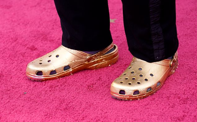 Musician Questlove was pictured wearing a pair of custom gold Crocs at the Oscars. (Photo / Getty)